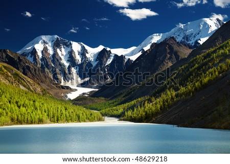 Beautiful Maashey lake in Altai mountains at sunset - stock photo