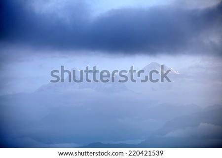 Beautiful Machhapuchhre and Annapurna range seen through the clouds - stock photo