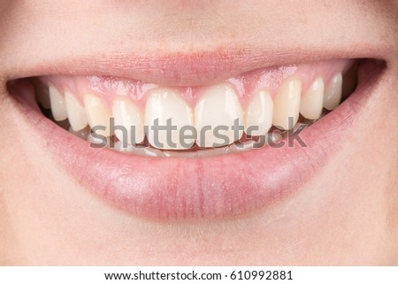 Beautiful macro close up of a young woman's smile