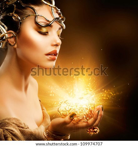 Beautiful Magic Woman Portrait. Golden Makeup.