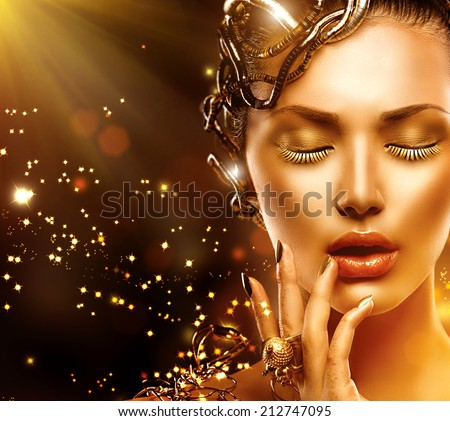 Beautiful Magic Woman Portrait. Golden Makeup. Model Girl face with gold skin, nails, make-up and accessories.