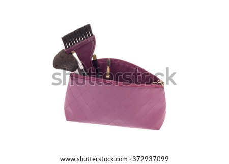 Beautiful make up bag with cosmetics - stock photo