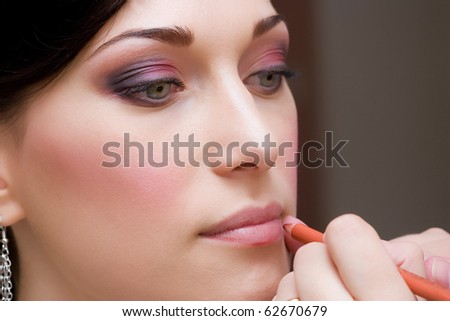 beautiful make up of brunette young lady closeup - stock photo