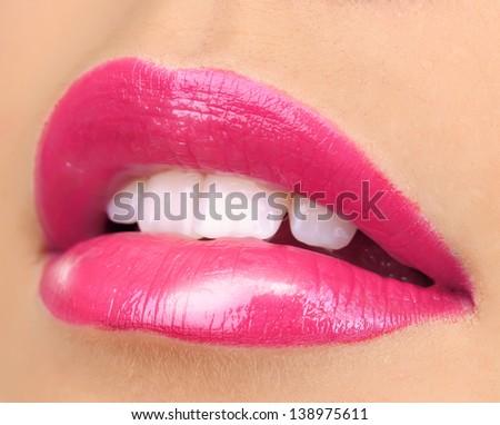 Beautiful make up of glamour pink gloss lips - stock photo