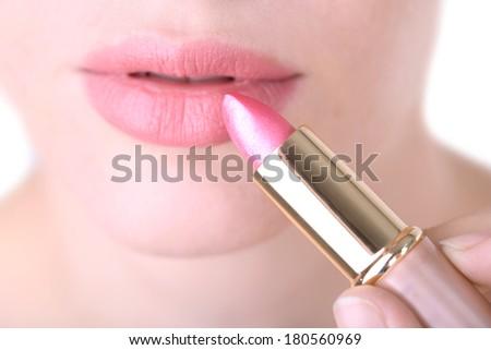 Beautiful make up of glamour pink gloss lips, close up - stock photo