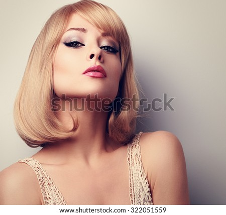 Beautiful makeup blonde woman with short hair style looking sexy. Closeup portrait - stock photo