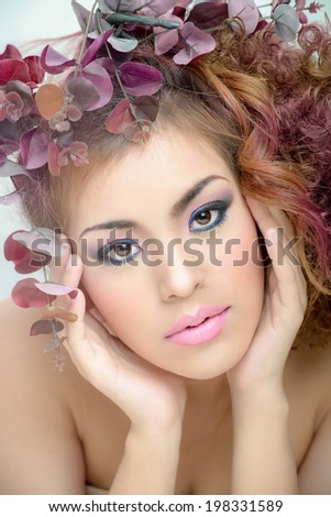 Beautiful makeup face art skin pink mouth shoe hands,hair , eyes art close up and hat from pink, Brown , purple, leaves tubes   spiral hairs beauty skin - stock photo