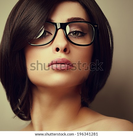 Beautiful makeup fashion girl in modern glasses looking. Closeup portrait - stock photo
