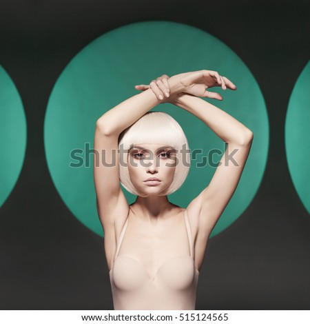 Beautiful makeup. Sexy woman with art makeup. Nude sexy blonde with smoke on the background. Woman with professional makeup. Female fashionable makeup. Beautiful nude blonde with sexy evening makeup.