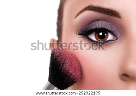 Beautiful makeup woman with make up brush on white with copy space. Blush. - stock photo