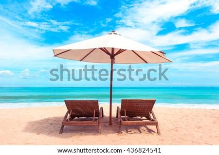 Beautiful Maldive beach. Beach chairs on the white sand beach with cloudy blue sky - stock photo