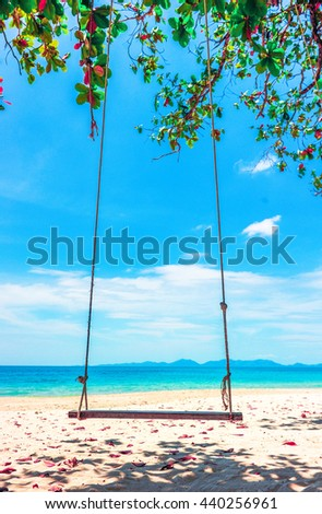 Beautiful Maldive beach. Swing hang from tree over beach. Summer holiday and vacation concept. - stock photo