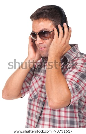 beautiful man listening music  with headphones on - stock photo