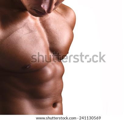 Beautiful man torso on white background - stock photo