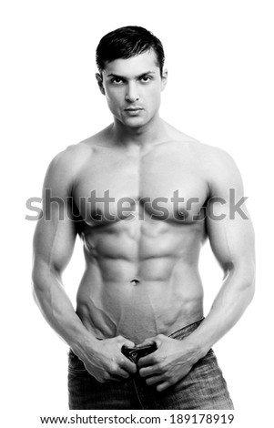 Beautiful man with muscular body isolated on white. - stock photo