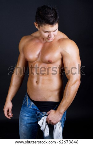 Beautiful man with naked torso - stock photo