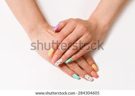 beautiful manicure, nail polish of different colors on the female nails - stock photo