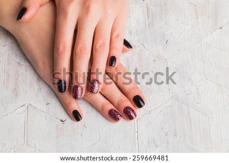 Beautiful manicure nails. Beautiful female hands with nails painted nails. Art manicure. Art manicure. Creative manicure. Taking Close-up nails. Art nails. Nails art. Art manicured fingers. - stock photo
