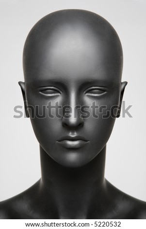 beautiful mannequin standing alone on the light white background