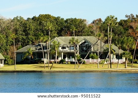 Beautiful mansion home on the ocean - stock photo