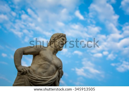 Beautiful marble sculpture of ancient greek god - stock photo