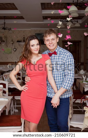 Beautiful married couple  in trendy clothing sitting in vintage cafe. Vintage design and accessories. Wedding day. Daylight. Indoor shot