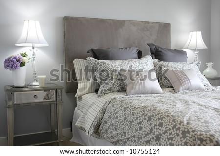 Beautiful master bedroom in classic grey. - stock photo