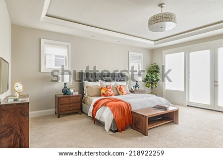 Beautiful Master Bedroom in New Luxury Home - stock photo