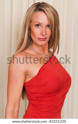 Beautiful mature blonde in a red dress