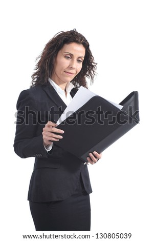 Beautiful mature businesswoman reading a report from a blue folder on a white isolated background