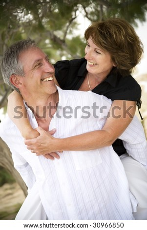 beautiful mature couple having fun - stock photo