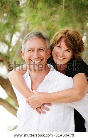Beautiful mature couple having fun. Shallow DoF with focus on the woman.