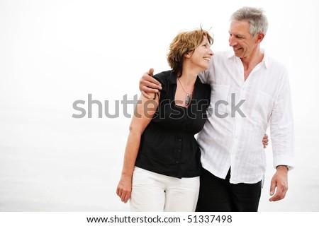 Beautiful mature couple taking a romantic walk - stock photo