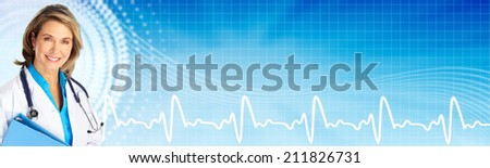 Beautiful mature doctor woman over blue hospital background - stock photo
