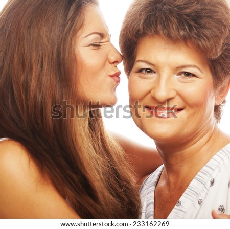 beautiful mature mother and daughter smiling - stock photo