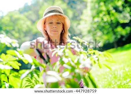 Beautiful mature woman gardening.