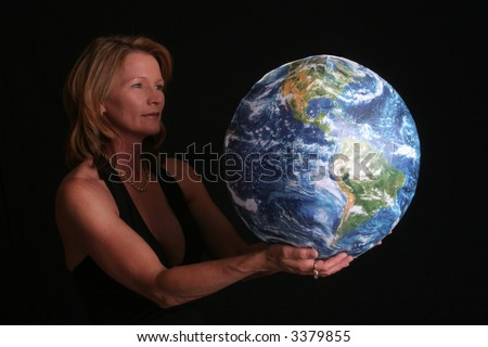 Beautiful, mature woman holding the world in her hands