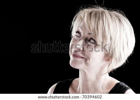 Beautiful Mature Woman On Black, portrait of an actress on stage - stock photo