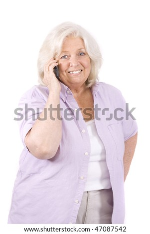 Beautiful mature woman on white using a cell phone - stock photo