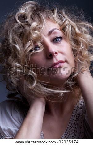 Beautiful mature woman portrait - feeling good expression - stock photo