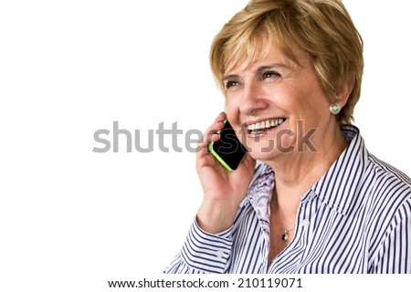 Beautiful mature woman speaking on the phone on a white background - stock photo
