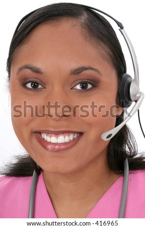 Beautiful Medical Receptionist Wearing Headset. - stock photo