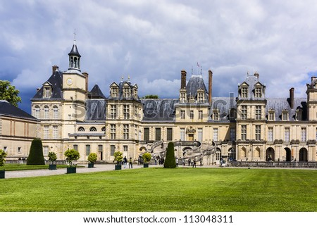 Beautiful Medieval landmark - royal hunting castle Fontainbleau. Palace of Fontainebleau - one of largest royal chateaux in France (55 km from Paris), UNESCO World Heritage Site.
