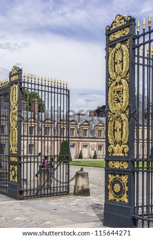 Beautiful Medieval landmark - royal hunting castle Fontainbleau. Palace of Fontainebleau - one of largest royal chateaux in France (55 km from Paris), UNESCO World Heritage Site. Fragment of fence. - stock photo