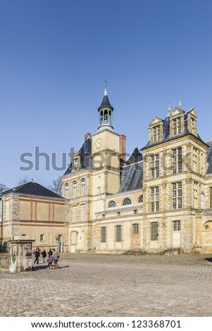 Beautiful Medieval landmark - royal hunting castle Fontainbleau. Palace of Fontainebleau - one of largest royal chateaux in France (55 km from Paris), UNESCO World Heritage Site. - stock photo