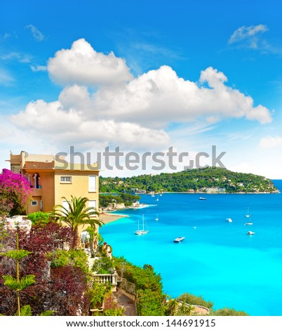 beautiful mediterranean beach landscape, view of luxury resort and bay of Villefranche-sur-Mer, Cote d'Azur, Provence, french riviera, France near Nice and Monaco - stock photo