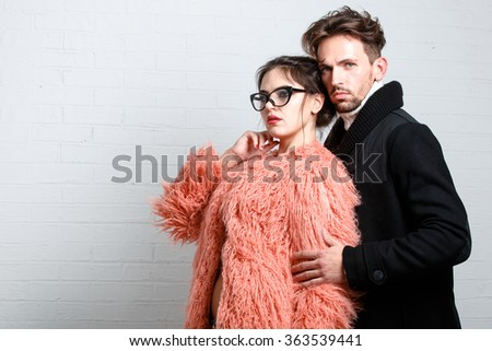 Beautiful men and women in fashionable winter clothes - stock photo