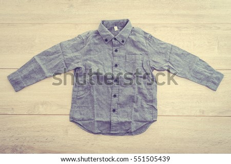 Beautiful men fashion shirt for clothing on wooden background - Vintage Filter Processing