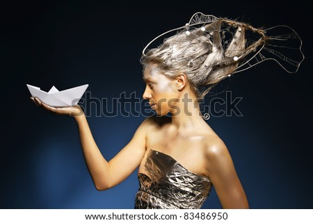 beautiful mermaid with a paper ship - stock photo