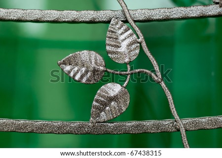 Beautiful Metal Leaves Carving on a gate - stock photo